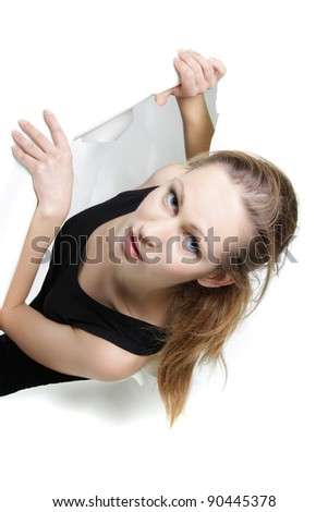young woman getting out from hole in paper