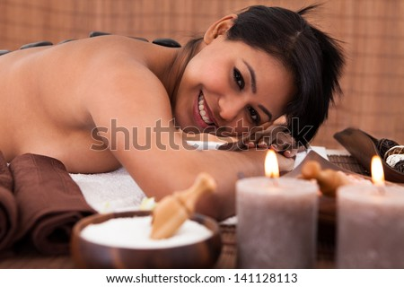 Young Woman Getting Spa Treatment With Stone Massage