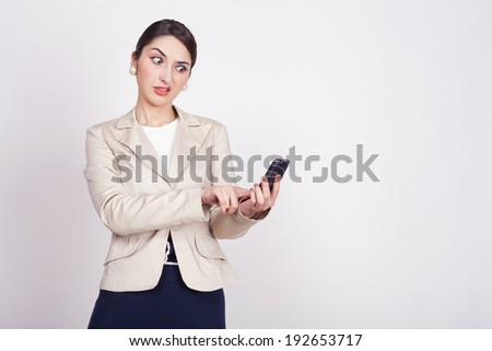 young woman holding a phone