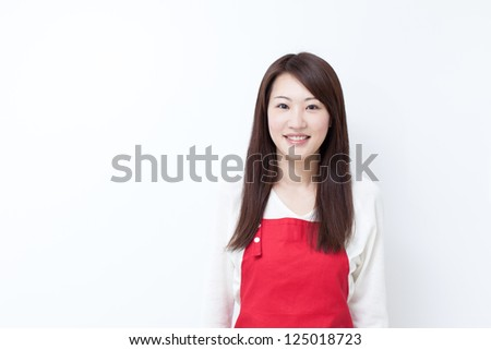 Young woman in apron showing copy space