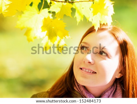 Young woman in autumn park. Outdoor portrait.