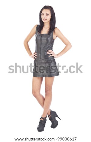 young woman in black leather, studio shot