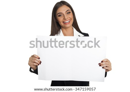 Young woman in black suit holding white sheet of paper