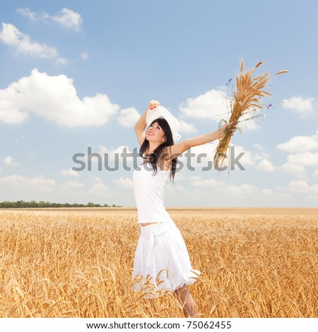 Young woman in golden wheat