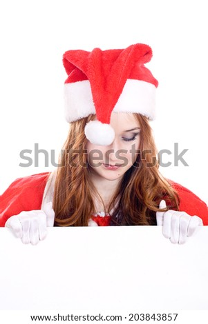 Young woman in Mrs Santa Claus hat holding a blank sign. Isolated on white. Extra white space with your message can be added to the bottom of the picture.