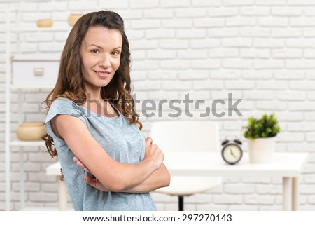 Young woman in office interior