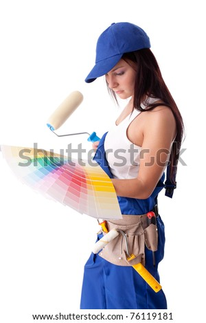 Young woman in overalls with a color guide and paintbrush on a white background.