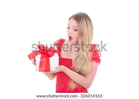 Young woman in Santa hat is surprised by new year gift