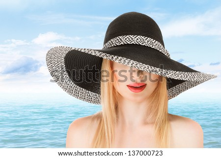 Young woman in sunhat at beach sunny day outdoor