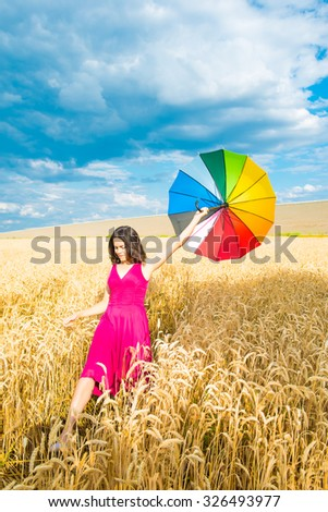 young woman in the field,  umbrella