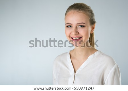young woman in white shirt on gray background