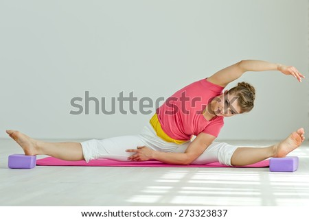 Young woman in yoga pose. Series.