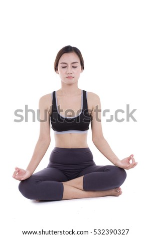young woman in yoga pose sitting on a floor.  white background isolated. asia