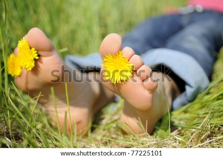 young woman is barefoot in a meadow
