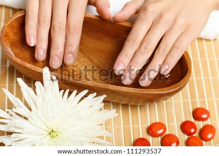Young woman is getting manicure in a beauty salon