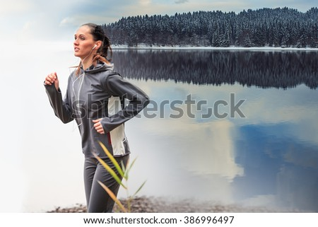 young woman jogging at a lake