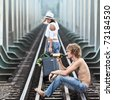 Young woman leaving men on a train tracks - stock photo