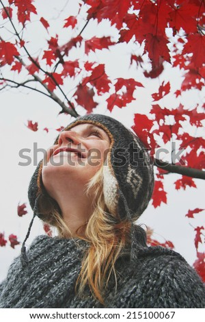 Young woman looking at the autumn sky