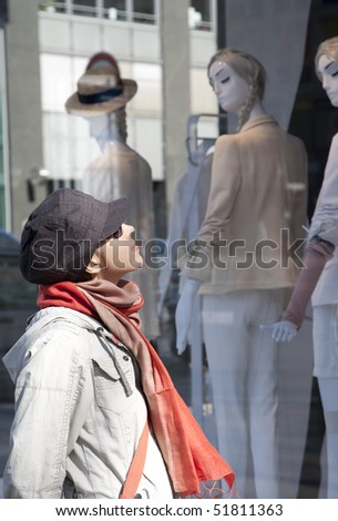 Young woman Looking Inside A Shop's Window