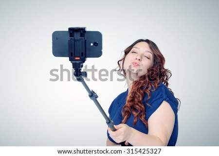 funny girl grimaces makes selfie on stock photo 602968727 shutterstock. Black Bedroom Furniture Sets. Home Design Ideas