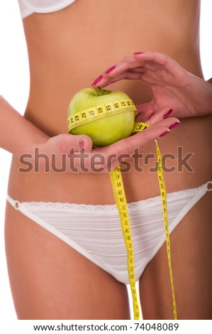 Young woman measuring her waist, isolated on white background