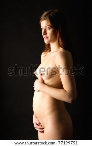 Young Woman Months Pregnant Standing Nude On A Black Background