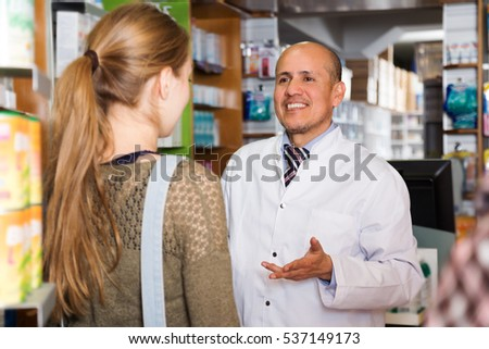 Young woman near counter in apothecary