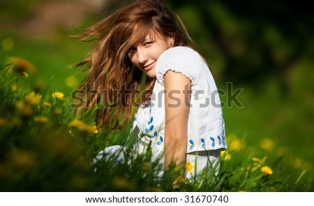 Young woman on a summer field. Shallow dof.