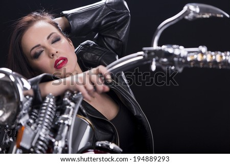 Young woman on motorcycle
