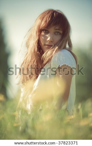 Young woman outdoors portrait. Soft colors.