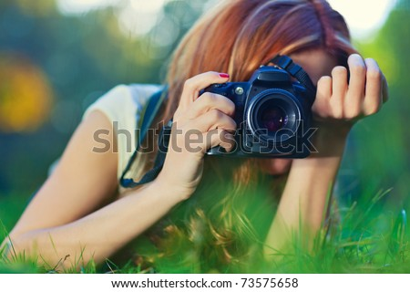 Young woman photographer portrait. Soft colors.