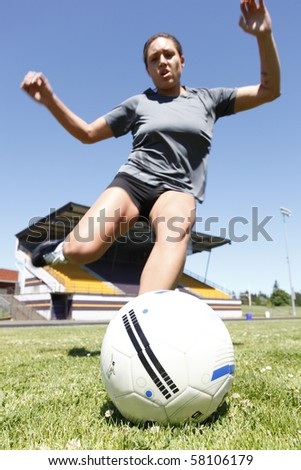 Young woman playing soccer.