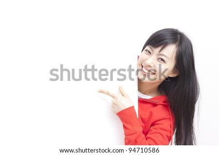 young woman pointing her finger at  blank board