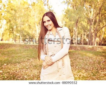 young woman posing in autumn park