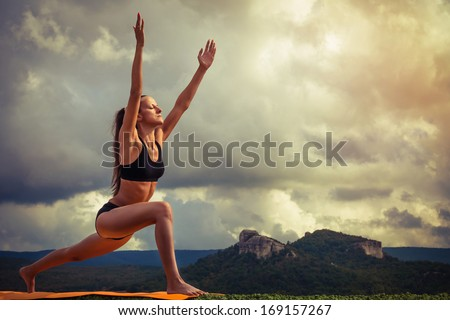 woman doing lotus position hands crossed stock photo