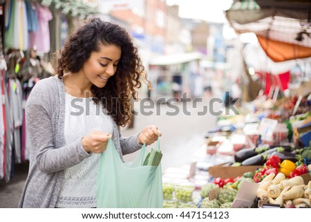 young woman shopping at the market