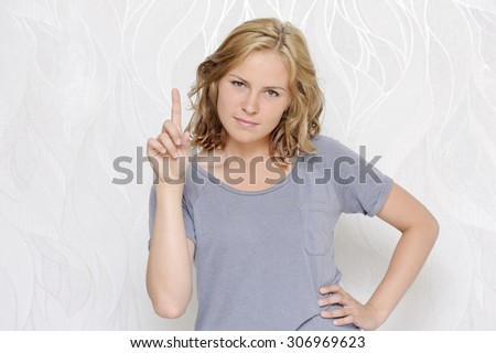 Young woman showing index finger