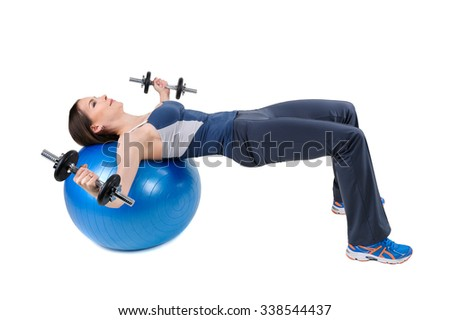 Young woman shows starting position of Fitball Dumbbell Chest Fly's Workout, isolated on white
