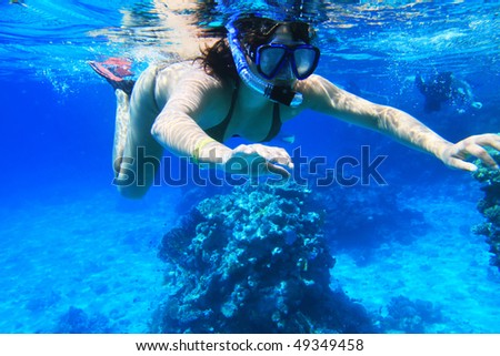 Young woman snorkeling near Tiran Island in Red Sea
