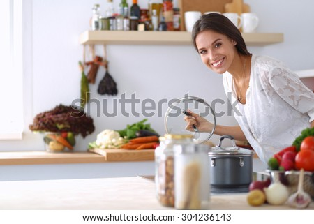 Young Woman Standing By Stove Kitchen Stock Photo 306416300 ...