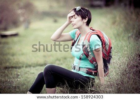 Young woman tourist with a headache