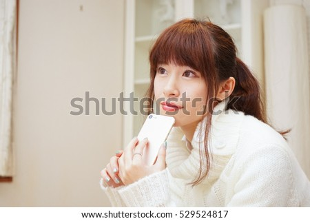 Young woman using a smart phone with smile