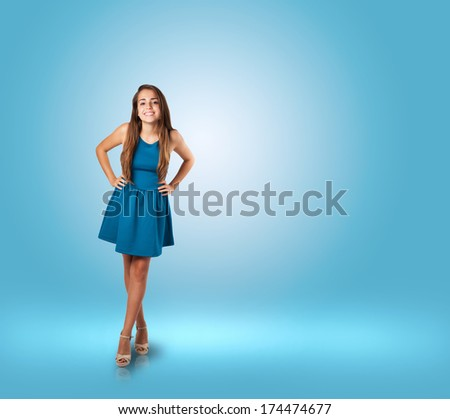 young woman wearing a blue dress at a blue room