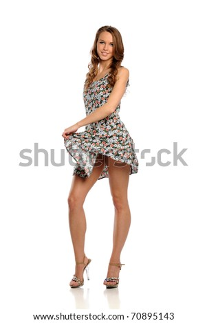 Young Woman wearing a summer dress isolated on a white background
