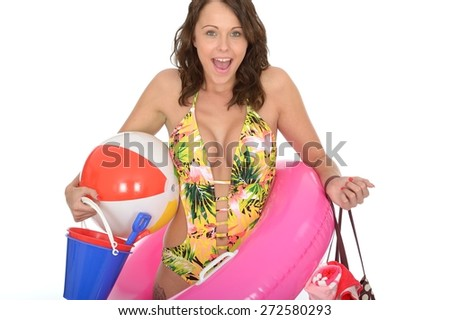 Young Woman Wearing a Swim Suit on Holiday Carrying a Bucket and Spade Rubber Ring Beach Ball and Shoulder Bag