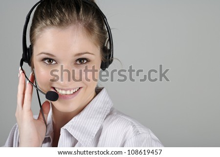 Young woman wearing a telephone headset talking on the phone