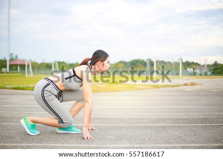 Young woman wearing sports clothes and ready to run on the track, sport women.