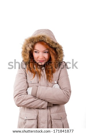 Young woman wearing winter clothes, waiting and freezing, isolated on white background.