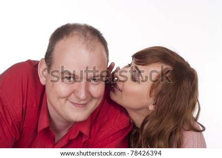 young woman whispering something to her man