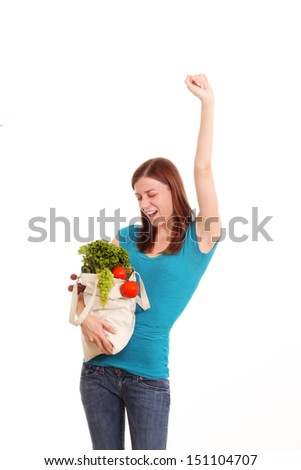 Young woman with a bag full of fruits and vegetables